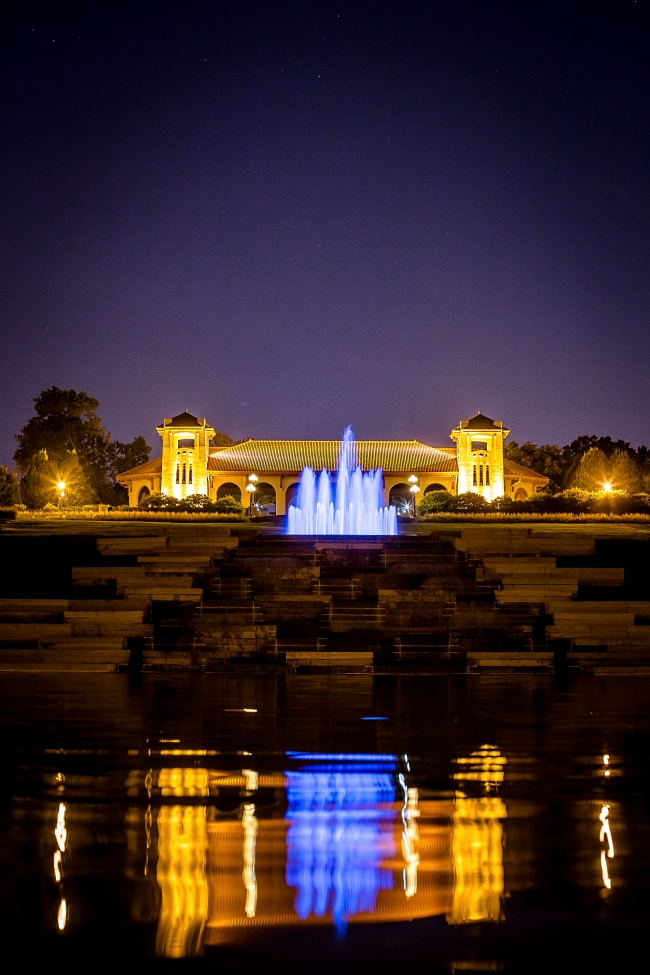 worlds fair pavilion with fountain at night-1 small