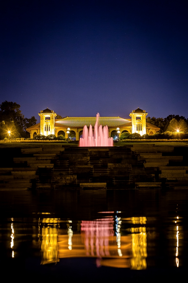 worlds fair pavilion with fountain at night-2 small